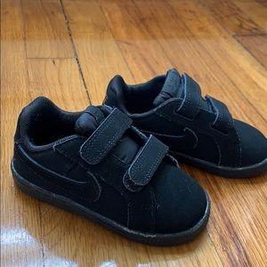 Black suede Nike sneakers